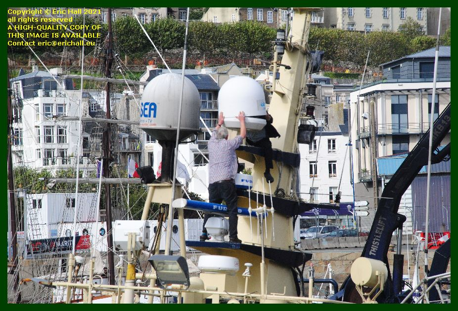 working on electronic equipment buddy m port de Granville harbour Manche Normandy France Eric Hall photo September 2021