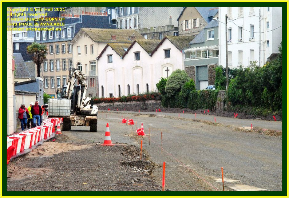 filling road markers with water rue du boscq Granville Manche Normandy France Eric Hall photo October 2021