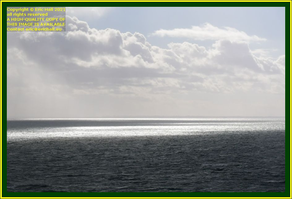 sun reflecting on surface baie de mont st michel Granville Manche Normandy France Eric Hall photo October 2021