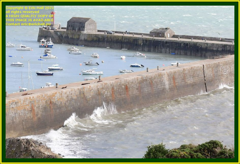 waves breaking on harbour wall port de Granville harbour Manche Normandy France Eric Hall photo October 2021
