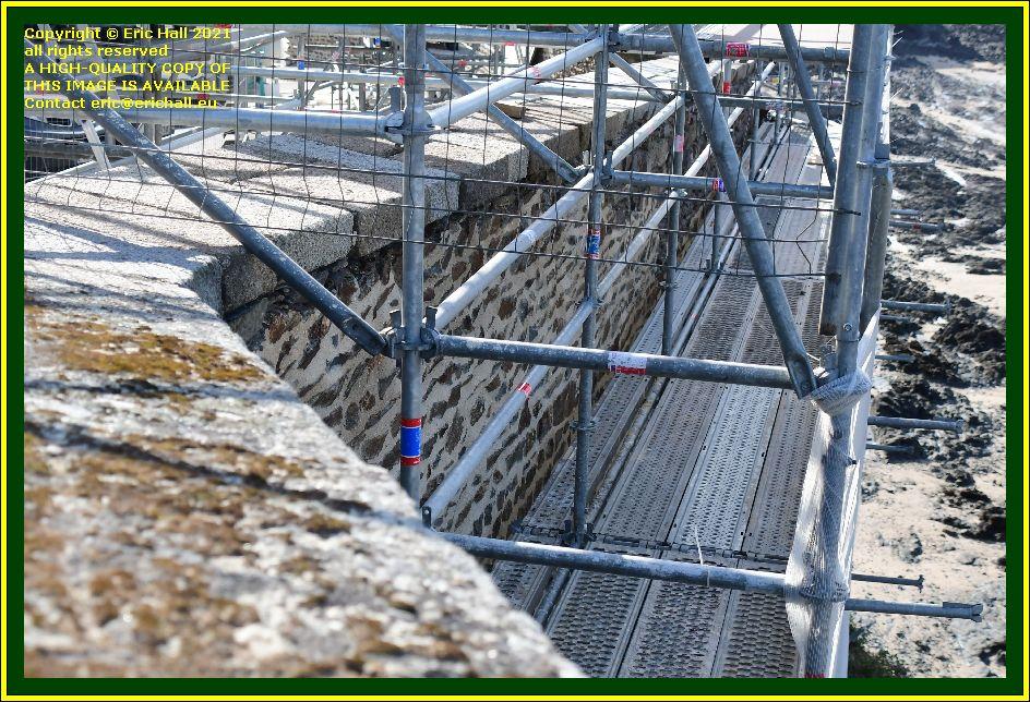repairing medieval city walls place du marché aux chevaux Granville Manche Normandy France Eric Hall photo October 2021