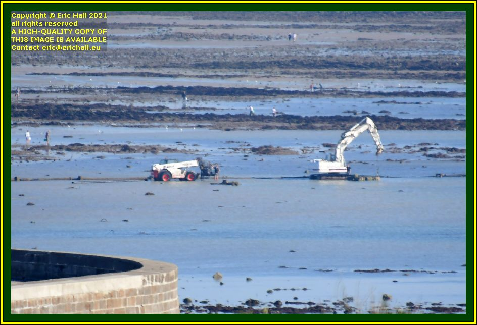 digger heavy machine laying pipeline baie de mont st michel Granville Manche Normandy France Eric Hall photo October 2021